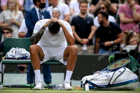Nick Kyrgios of Australia reacts after picking up an injury during the 3rd round match against Felix Auger-Aliassime of Canada at the Wimbledon Championships, in Wimbledon, Britain, 03 July 2021.