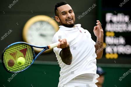 Nick Kyrgios of Australia hits a forehand during the 3rd round match against Felix Auger-Aliassime of Canada at the Wimbledon Championships, in Wimbledon, Britain, 03 July 2021.