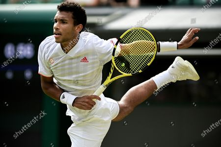 Felix Auger-Aliassime of Canada serves during the 3rd round match against Nick Kyrgios of Australia at the Wimbledon Championships, in Wimbledon, Britain, 03 July 2021.