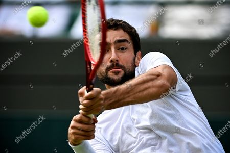 Marin Cilic of Croatia hits a backhand during the 3rd round match against Daniil Medwedew of Russia at the Wimbledon Championships, in Wimbledon, Britain, 03 July 2021.