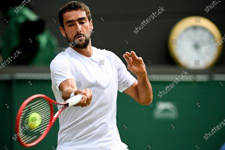 Marin Cilic of Croatia hits a forehand during the 3rd round match against Daniil Medwedew of Russia at the Wimbledon Championships, in Wimbledon, Britain, 03 July 2021.