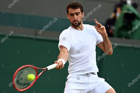 Stock Photo of Marin Cilic of Croatia during the 3rd round match against Daniil Medvedev of Russia at the Wimbledon Championships, in Wimbledon, Britain, 03 July 2021.