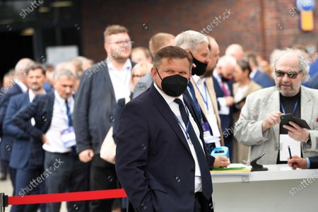 Member of the Law and Justice party (PiS) Wojciech Skurkiewicz (C) arrives for the Law and Justice party's congress at the EXPO XXI Center in Warsaw, Poland, 03 July 2021. The ruling conservative party's members convene to elect its party leader. It is widely expected Jaroslaw Kaczynski will continue in this role.