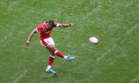 Ben Thomas of Wales kicks a conversion