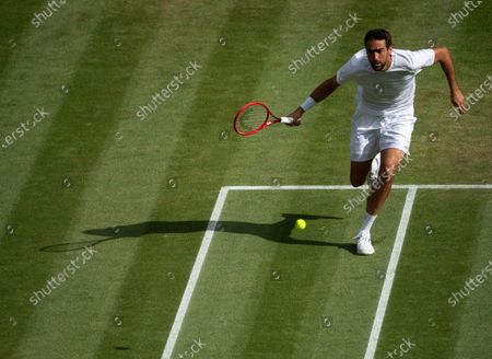 Marin Cilic of Croatia in action against Daniil Medvedev of Russia in their third round match of the Gentlemen's Singles for the Wimbledon Championships 2021 at The All England Lawn Tennis Club, Wimbledon, Britain, 03 July 2021.