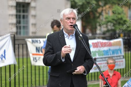 Stock Picture of John McDonnell speaks during the demonstration. On the weekend of the 73rd anniversary of the NHS in the UK, a nationwide demonstration was called for fair pay rise, patient safety and end of privatization to the NHS. Apart from the various protests that happened outside different NHS hospitals across the countries, NHS staffs in London marched from University College London Hospital to Downing Street to call the government to respond to their demands.