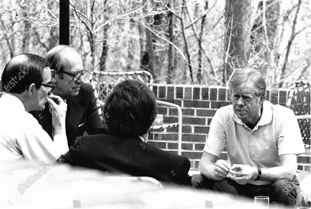 United States President Jimmy Carter, right, meets senior officials including US Undersecretary of State for Management Benjamin H. Read; US Undersecretary of State for Political Affairs David D. Newsom; and David Aaron, confer during a working weekend at Camp David, the presidential retreat near Thurmont, Maryland. Mandatory