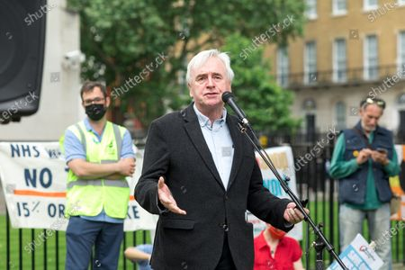 John McDonnell, Labour MP for Hayes and Harlington, giving a speech outside Downing Street during the march. Throughout the pandemic, the NHS has experienced understaffing. Health care workers have been working long hours and undergoing stress in relation to caring for large volumes of COVID 19 cases. Organised by Unite the Union, a march seeking to rebuke the 1% pay rise proposed by the Boris Johnson government, and demands a 15% pay rise took place from University College Hospital through Trafalgar Square and ended outside Downing Street.