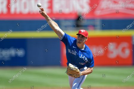 Toronto Blue Jays starting pitcher Ross Stripling (48) throws to a Tampa Bay Rays batter during the first inning of a baseball game in Buffalo, N.Y