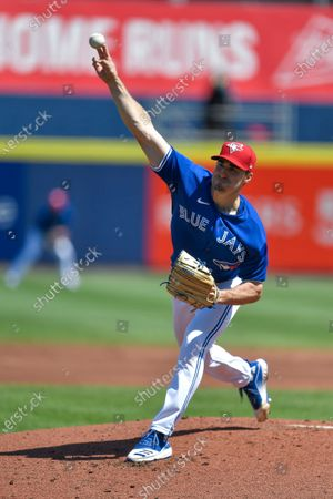 Toronto Blue Jays starting pitcher Ross Stripling (48) throws to a Tampa Bay Rays batter during the second inning of a baseball game in Buffalo, N.Y