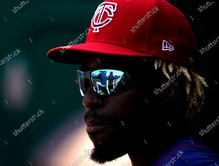Minnesota Twins' Nick Gordon watches from the dugout during the first inning of a baseball game against the Kansas City Royals, in Kansas City, Mo