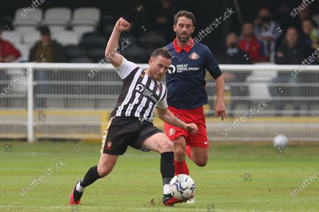Mark Anderson of Spennymoor Town passes away from Will Grigg of Sunderland during the Pre-season Friendly match between Spennymoor Town and Sunderland at the Brewery Field, Spennymoor on Saturday 3rd July 2021.