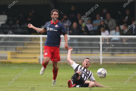 Will Grigg of Sunderland fouls Mark Anderson of Spennymoor Town during the Pre-season Friendly match between Spennymoor Town and Sunderland at the Brewery Field, Spennymoor on Saturday 3rd July 2021.