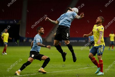 Uruguay's Nahitan Nandez, center, goes for a header during a Copa America quarterfinal soccer match against Colombia at the National stadium in Brasilia, Brazil