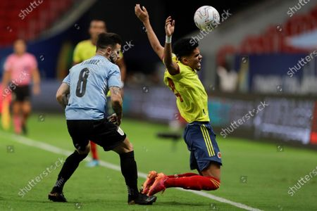 Uruguay's Nahitan Nandez (L) in action against Colombia's Luis Diaz, during the match between Uruguay and Colombia for the quarterfinals of the Copa America 2021, at the Mane Garrincha stadium in Brasilia, Brazil, 03 July 2021.
