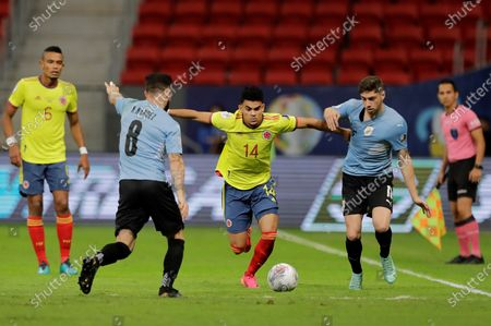 Stock Photo of Uruguay's Nahitan Nandez (L) and Federico Valverde (R) in action against Colombia's Luis Diaz, during the match between Uruguay and Colombia for the quarterfinals of the Copa America 2021, at the Mane Garrincha stadium in Brasilia, Brazil, 03 July 2021.