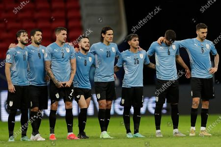 Stock Image of Players of Uruguay embrace after Jose Gimenez missed a penalty shot during a penalty shootout in a Copa America quarterfinal soccer match at the National stadium in Brasilia, Brazil