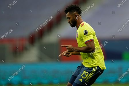 Colombia's Miguel Borja celebrates scoring from the penalty spot against Uruguay during a penalty shootout in a Copa America quarterfinal soccer match at the National stadium in Brasilia, Brazil, . Colombia won 4-2 and qualified to the semifinals