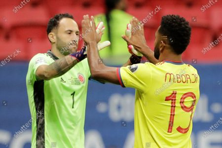 Colombia's Miguel Borja (R) celebrates with his teammate David Ospina (L) after scoring in the penalty shootout against Uruguay, during the Copa America 2021 quarterfinals soccer match between Uruguay and Colombia at the Mane Garrincha Stadium in Brasilia, Brazil, 03 July 2021.