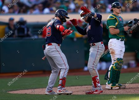 Boston Red Sox Enrique Hernandez (C) celebrates at home plate with Boston Red Sox Alex Verdugo (L) after hitting a solo home run off Oakland Athletics starting pitcher Cole Irvin as Oakland Athletics catcher Sean Murphy (R) looks on during the seventh inning of the Major League Baseball (MLB) game between the Boston Red Sox and the Oakland Athletics at RingCentral Coliseum in Oakland, California, USA, 03 July 2021.