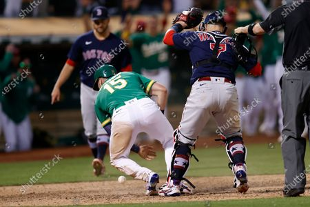 Oakland Athletics Seth Brown (L) slides safely into home plate for the game winning run on Oakland Athletics Tony Kemp's sacrifice RBI as Boston Red Sox catcher Christian Vazquez (R) can't hold on to the ball during the 12th inning of the Major League Baseball (MLB) game between the Boston Red Sox and the Oakland Athletics at RingCentral Coliseum in Oakland, California, USA, 03 July 2021.