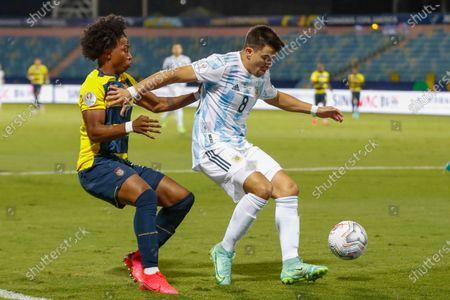 Ecuador's Angelo Preciado challenges for the ball Argentina's Marcos Acuna during a Copa America quarterfinal soccer match at the Olimpico stadium in Goiania, Brazil