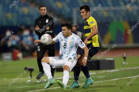 Ecuador's Alan Steven Franco, right, challenges Argentina's Marcos Acuna during a Copa America quarterfinal soccer match at the Olimpico stadium in Goiania, Brazil