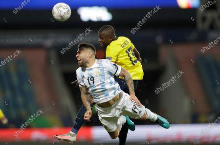 Argentina's Nicolas Otamendi (19) and Ecuador's Enner Valencia go for a header during a Copa America quarterfinal soccer match at the Olimpico stadium in Goiania, Brazil