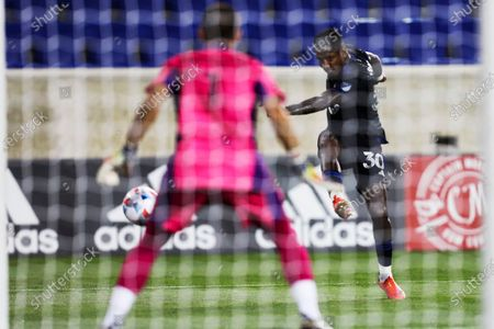 Montreal midfielder Romell Quioto scores against Inter Miami goalkeeper John McCarthy during an MLS soccer match, in Harrison, N.J
