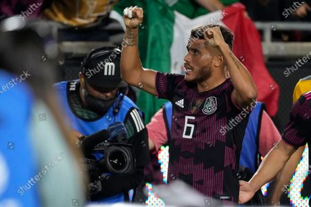 Mexico midfielder Jonathan Dos Santos (6) celebrates after scoring a goal during the second half of an international friendly soccer match against Nigeria, in Los Angeles