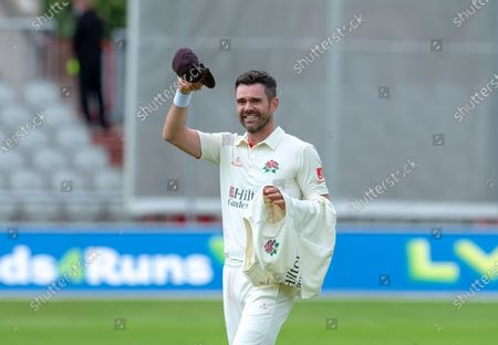 James Anderson doff his cap after claiming his 1000th career wicket in the game between Lancashire and Kent at Emirates Old Trafford