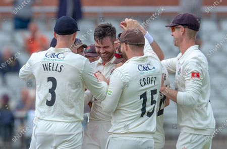 James Anderson congratulated by Lancashire team mates after claiming his 1000th career wicket