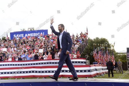 Donald John Trump Jr. walks onto the stage during a rally for former President Donald Trump at the Sarasota Fairgrounds, in Sarasota, Fla