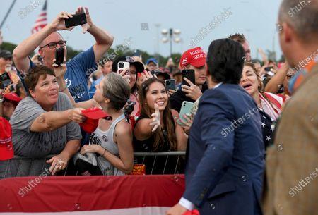 Donald John Trump Jr. signs autographs during a rally for former President Donald Trump at the Sarasota Fairgrounds, in Sarasota, Fla