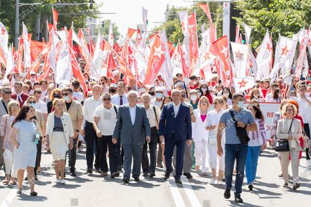 """Socialists and communists supporters, with former presidents Vladimir Voronin (C-L) and Igor Dodon (C-R) attend a march with the slogan """"We love Moldova"""" in downtown Chisinau, Moldova, 04 July 2021. Protesters accuse the presidential institution of  betraying national interests."""