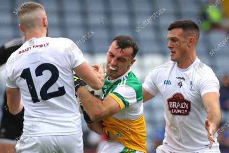 Kildare vs Offaly. Kildare's Neil Flynn and Eoin Doyle tackle Colm Doyle of Offaly