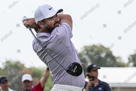 Stock Picture of Jason Day of Australia hits his tee shot on the third hole during the fourth round of the Rocket Mortgage Classic golf tournament at the Detroit Golf Club in Detroit, Michigan, USA, 04 July 2021.
