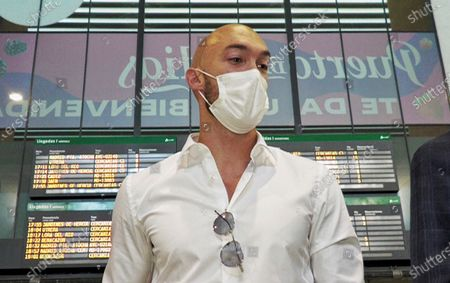Serbian goalkeeper Marko Dmitrovic wears a protective face mask as he arrives at the airport in Seville, Spain, 04 July 2021. Dmitrovic is set to join Spanish La Liga side Sevilla FC.
