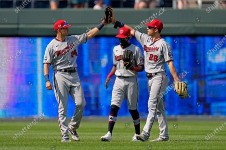 Minnesota Twins outfielders Trevor Larnach (24), Max Kepler (26) and Nick Gordon celebrate after their baseball game against the Kansas City Royals, in Kansas City, Mo. The Twins won 6-2