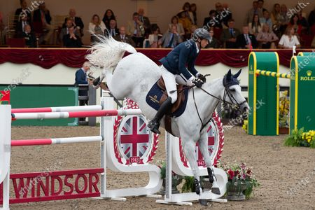 The Rolex Grand Prix Jump Off at Royal Windsor Horse Show. Ben Maher from Great Britain came first. Ben Maher was presented to HRH The Duke of Wessex