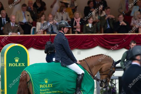 Ben Maher wins the The Rolex Grand Prix at Royal Windsor Horse Show. Ben Maher was presented to HRH The Duke of Wessex
