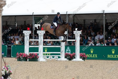 Joseph Stockdale, Great Britain, rides horse Equine America Cacharel. The Rolex Grand Prix Jump Off at Royal Windsor Horse Show. Ben Maher from Great Britain came first. Ben Maher was presented to HRH The Duke of Wessex