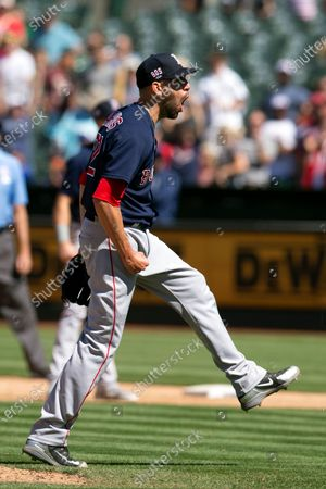 Boston Red Sox pitcher Matt Barnes (32) reacts to striking out Oakland Athletics' Seth Brown for the final out in the ninth inning of a baseball game, in Oakland, Calif. Barnes earned the save in his team's 1-0 victory