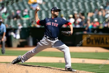Boston Red Sox pitcher Matt Barnes (32) delivers against the Oakland Athletics during the ninth inning of a baseball game, in Oakland, Calif
