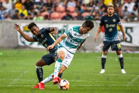 Stock Picture of América midfielder Pedro Aquino, left, fights for the ball with Santos Laguna forward Jesús Ocejo during a Liga MX friendly soccer match, in Sandy, Utah