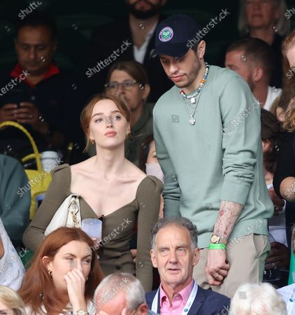 Phoebe Dynevor and Pete Davidson watching Federer v Norrie in the third round.
