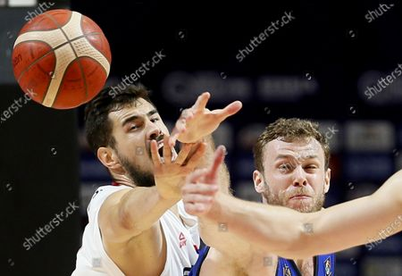 Stock Image of Serbia's Nikola Kalinic (L) lives with Italy's Nicolo Melli (R) during FIBA Olympic Qualifying Tournament basketball final match between Serbia and Italy in Belgrade, Serbia on July 4, 2021.