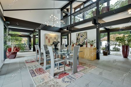 Dining area.   The UK home of Hollywood actor Antonio Banderas is on the market for £2.95m.  The Mask of Zorro star moved from LA to Cobham in Surrey in 2015 with girlfriend Nicole Kimpel after splitting from his wife of 20 years Melanie Griffiths.  They are now selling their home to spend more time in Banderas' native Malaga, where he has bought and built a theatre.