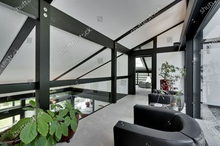 First floor landing.   The UK home of Hollywood actor Antonio Banderas is on the market for £2.95m.  The Mask of Zorro star moved from LA to Cobham in Surrey in 2015 with girlfriend Nicole Kimpel after splitting from his wife of 20 years Melanie Griffiths.  They are now selling their home to spend more time in Banderas' native Malaga, where he has bought and built a theatre.