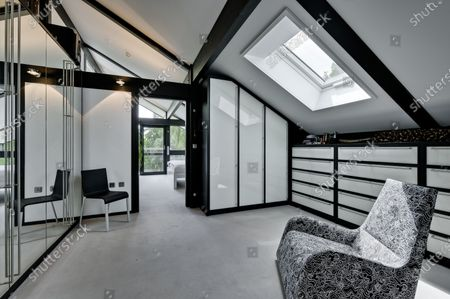 Dressing area.   The UK home of Hollywood actor Antonio Banderas is on the market for £2.95m.  The Mask of Zorro star moved from LA to Cobham in Surrey in 2015 with girlfriend Nicole Kimpel after splitting from his wife of 20 years Melanie Griffiths.  They are now selling their home to spend more time in Banderas' native Malaga, where he has bought and built a theatre.